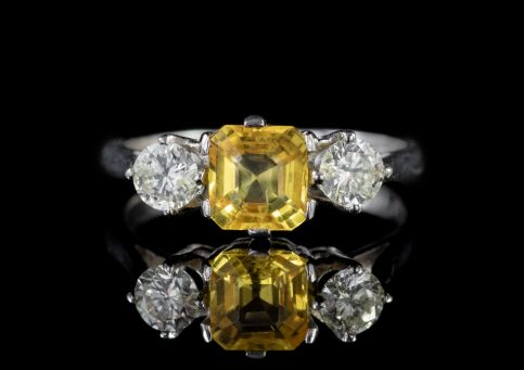 ANTIQUE EDWARDIAN YELLOW SAPPHIRE DIAMOND TRILOGY RING PLATINUM CIRCA 1915 front