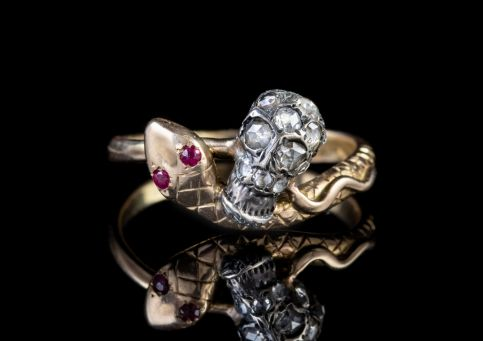 MEMENTO MORI DIAMOND SKULL AND RUBY SNAKE INTERTWINED RING  front