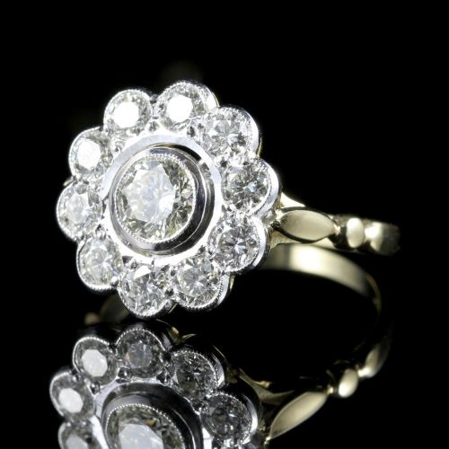 DIAMOND CLUSTER RING 18CT GOLD 0 70CT CENTRE DIAMOND