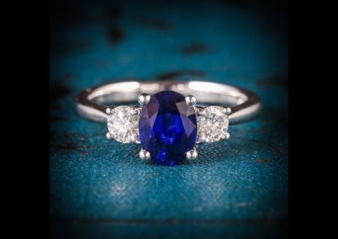 SAPPHIRE_DIAMOND_TRILOGY_RING_PLATINUM_ENGAGEMENT_RING_COVER