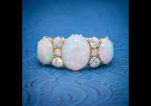 ANTIQUE_VICTORIAN_NATURAL_5CT_OPAL_TRILOGY_RING_18CT_GOLD_CIRCA_1880_cover-500x500.jpg
