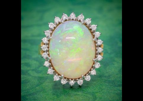 VINTAGE_12CT_NATURAL_OPAL_CLUSTER_RING_18CT_GOLD_CIRCA_1960_cover-500x500.jpg