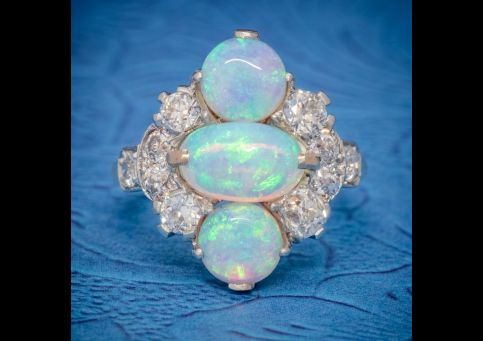 VINTAGE_OPAL_CLUSTER_RING_14CT_GOLD_PLATINUM_5CT_OPAL_CIRCA_1930_cover-500x500.jpg